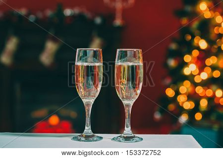 Beautiful Two Glasses Of Champagne Standing On The Table In The Background Of A Blurred Room With A
