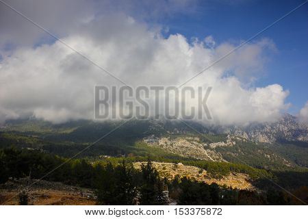 Turkey mountains and clouds on sunny day.