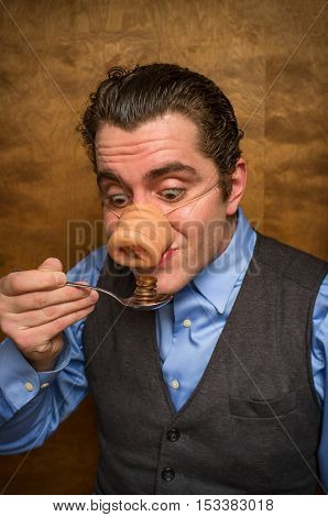 Silly pig man eating lose change for banking greed image