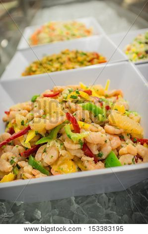 Chilled shrimp ceviche salad in square shaped fancy bowl