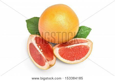whole grapefruit and two wedges on white with green leaf.