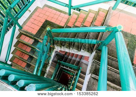 Upside view of a old spiral staircase of tower