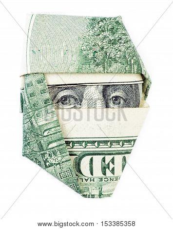 One hundred dollars folded into ninja isolated on white background. Ninja Franklin concept.