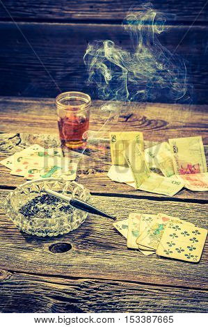 Vintage Table For Illegal Poker With Vodka, Cigarettes And Cards