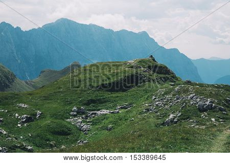 Travelers Or Hikers In The Mountains In The National Park Triglav.