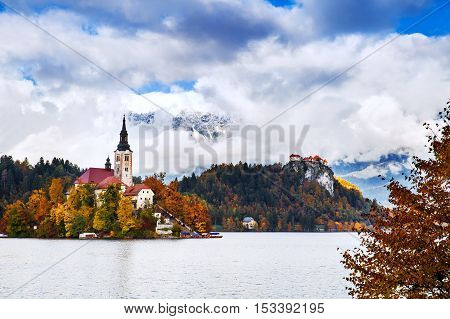 Amazing View On Bled Lake. Autumn in Slovenia Europe. View on Island with Catholic Church in Bled Lake with Castle and Mountains in Background.