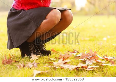Female With Maple Leaves In Hand. Autumnal Park Scenery