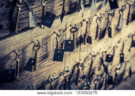 Closeup of aged keys with number in hotel