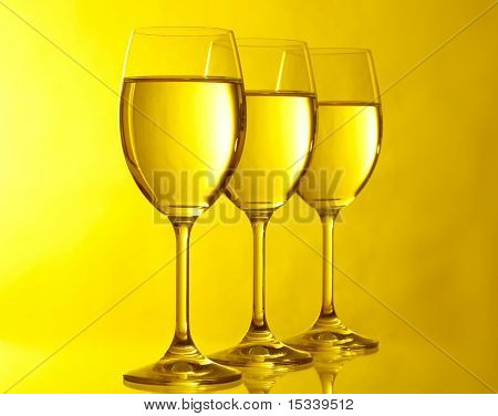 Three glasses on yeloow background