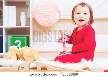 Happy Toddler Girl Playing With Her Teddy Bear