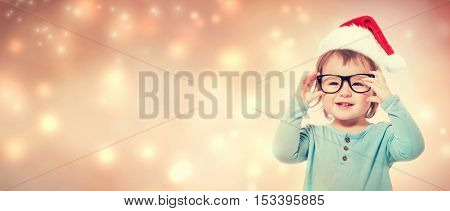 Toddler Girl With Santa Hat Wearing Glasses