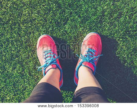 Female Jogger Looking Down At Her Feet
