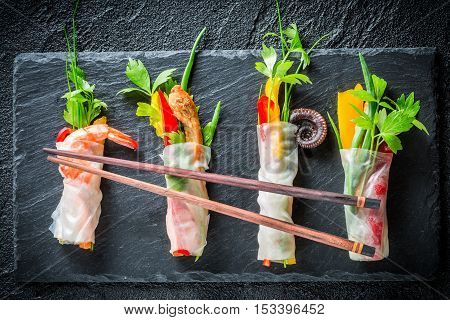 Four Kinds Of Spring Rolls With Vegetables And Seafood