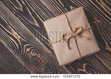 Classy Christmas gifts box presents on brown wooden background. Christmas and Happy New Year concept.