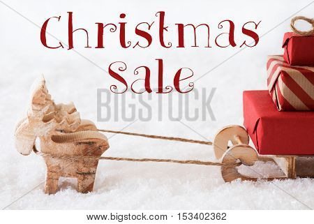 Moose Is Drawing A Sled With Red Gifts Or Presents In Snow. Christmas Card For Seasons Greetings. English Text Christmas Sale