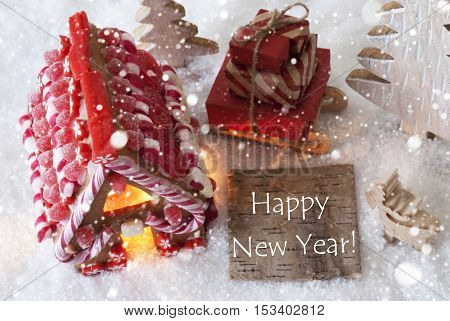 Label With English Text Happy New Year. Gingerbread House On Snow With Christmas Decoration Like Trees And Moose. Sleigh With Christmas Gifts Or Presents And Snowflakes.