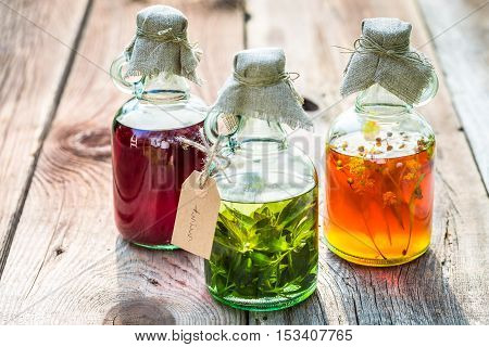 Bottles With Honey, Linden, Mint And Alcohol As Natural Medicine