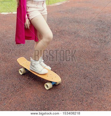 Superhero Girl Playing Skateboard Activity Concept