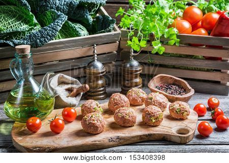 Preparations For The Meatballs With Cabbage And Tomatoes