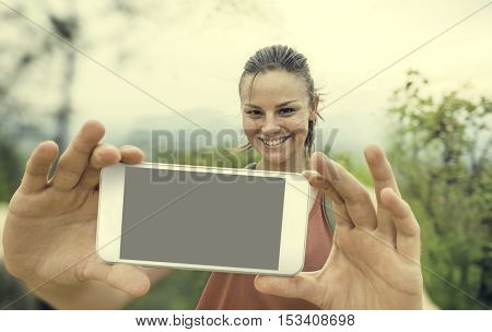 Girl Taking Selfie Outdoors Concept