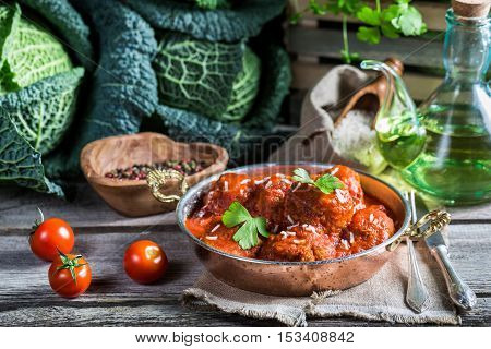 Homemade Meatballs With Tomato Sauce And Cabbage