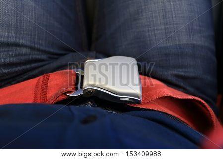 Locked Red Passenger Airplane Belt