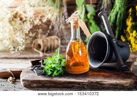 Therapeutic Tincture In Bottles Made Of Honey And Mint Leaf
