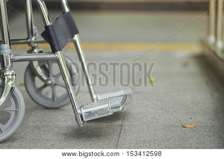 Empty wheelchair parked in hospital, healthy concept