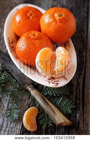 New Year's mood: tangerines and fir branch