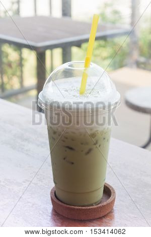 Iced green tea on wooden table, stock photo