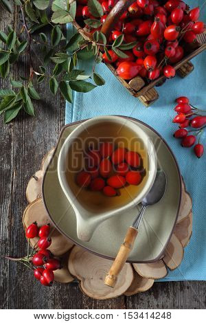 Rosehip tea and berries in basket top view