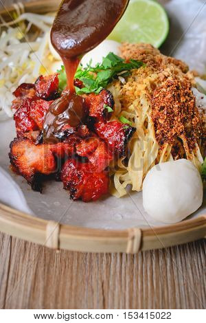 Egg Noodles and Red Pork with Suace Topping on wood background Noodles Thai Style Thai Noodles Thai Food Thai Cuisine