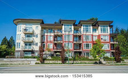 New apartment building on sunny day in British Columbia Canada.