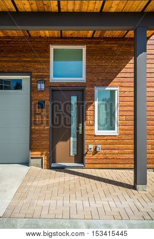 Entrance of brand new townhouse with wood siding