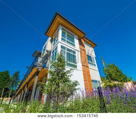 Brand new townhouse complex on sunny day in British Columbia
