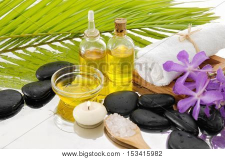 spa concept with palm ,towel, orchid, stones ,oil,salt in spoon