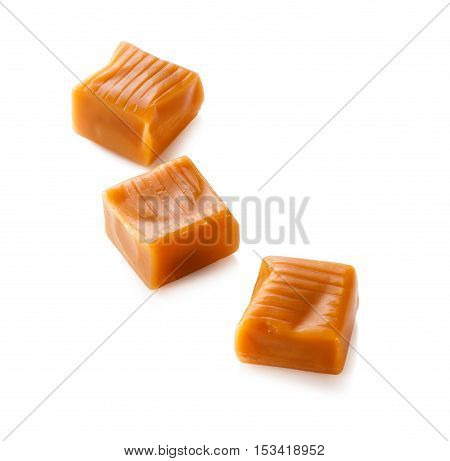 three toffee caramel candies close-up isolated on white background (with clipping path)