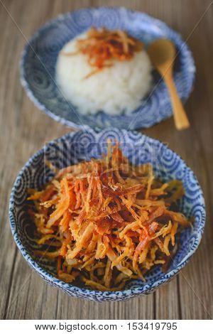 Moo Foy, Thai Dried Shredded Pork on Blue Plate and Wood Backgroound Thai Food Thai Cuisine