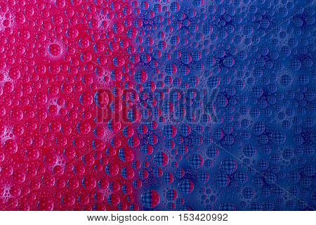 Colorful abstract of water drops on a glass surface
