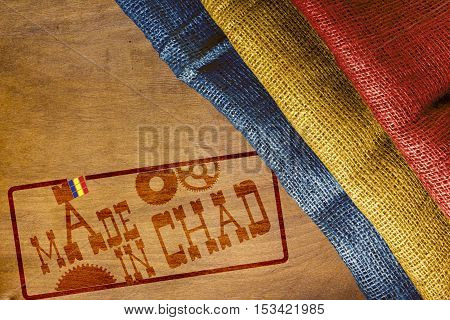 Made in Chad - Flag and industrial imprint the stamp.