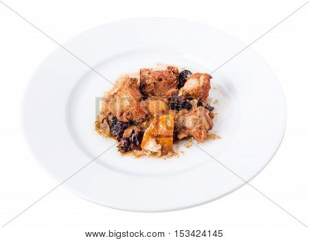 Traditional baked pork with dried plums and walnuts. Isolated on a white background.