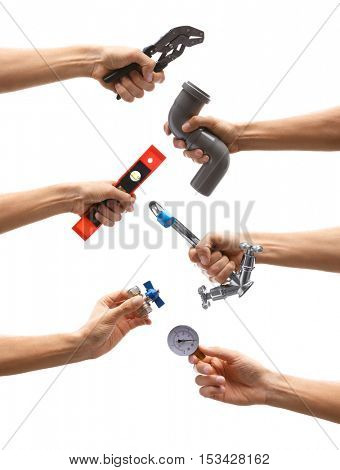 Set of male hands holding plumbing equipment on white background. Repair and maintenance concept.