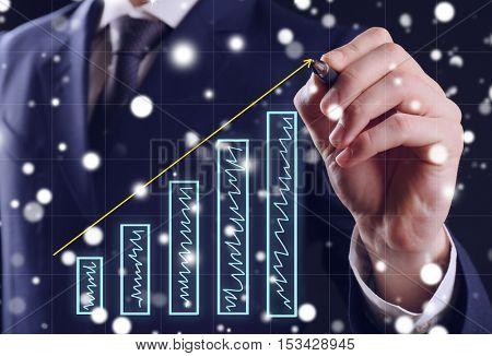 Businessman drawing graph on virtual screen, closeup. Snowy effect.
