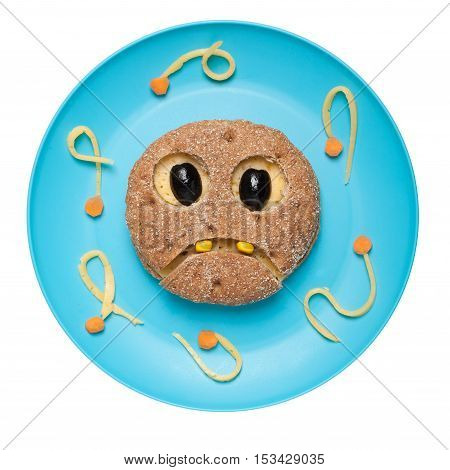 Ghost made of bread on blue plate