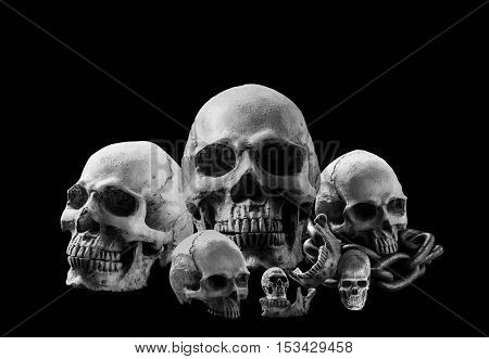 Skulls and old chains with a black and white image.