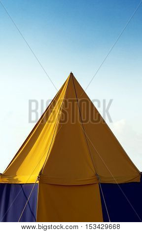 A big yellow medival theme tent standing.