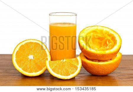 freshly squeezed orange juice with slices on a board with a white background