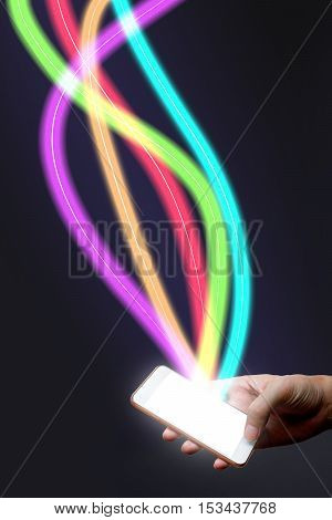 Man holding mobile phone and fiber optical light network.