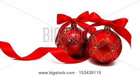 Perfect red christmas balsl with ribbon isolated on a white background