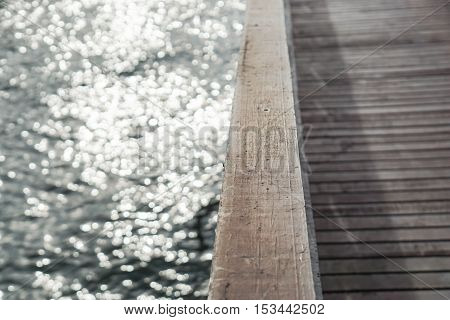 water sparkling on wooden bridge at riverside with selective focus